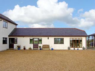 BRYN COED COTTAGE, pet friendly, country holiday cottage, with hot tub in