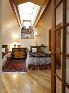 Delightful twin bedroom with skylight