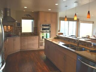 Kitchen with granite counter tops and stainless steel appliances.