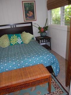 queen size bed, bedroom has garden view
