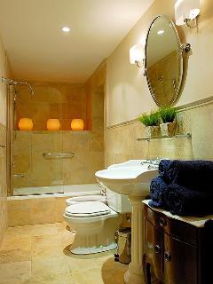 Main bathroom upstairs with tub
