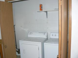 Utility room with washer and dryer