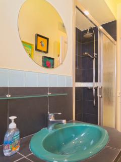 Spacious tiled shower with unlimited hot water
