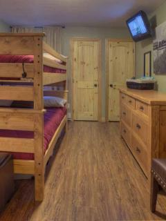 Closet space, tv, luxory sheets, and ample storage for your stay!
