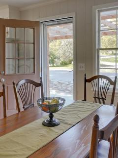 Seat 6 adults at this lovely antique oak dining room table with gorgeous views of back yard!
