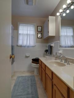 Light and bright, fresh white glazed tile, shower tub combo with fixed and handheld showerhead!