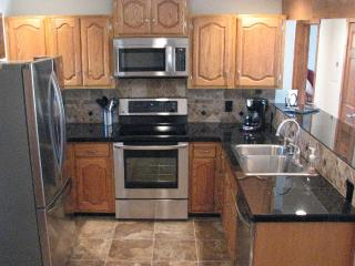 Kitchen w/ Oversized Granite Tile Counters
