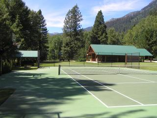 Tennis and basketball court with incredible mountain view