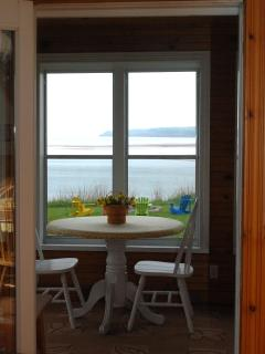 Eating area in Sunroom overlooking Howe Bay