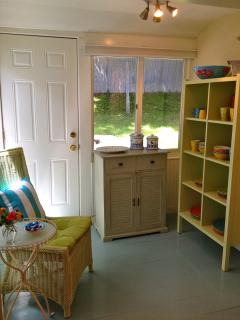 Sunroom off kitchen with new Maine Cottage cabinet full of fun new dishes