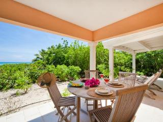 Outside covered terrace with teak loungers, dining table and chairs for al fresco dining