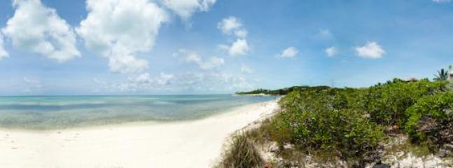 Beautiful long quiet beach. Great for swimming, snorkeling and shelling. Look for conch shells.