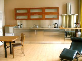 Italian design kitchen in cherrywood and inox