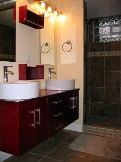 Roomy Master Bathroom,  double sink and huge walk in shower with bench