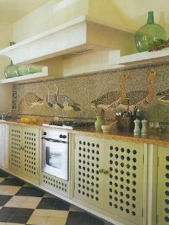 The fully equipped kitchen has a 5m mosaic with design of Egyptian geese.