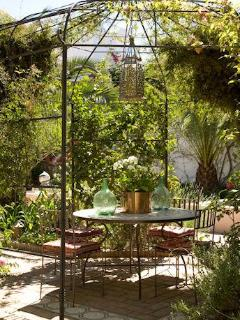 The shady and jasmine scented pergola for outside eating in the garden.