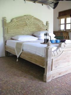 master bedroom with adjacent bathroom