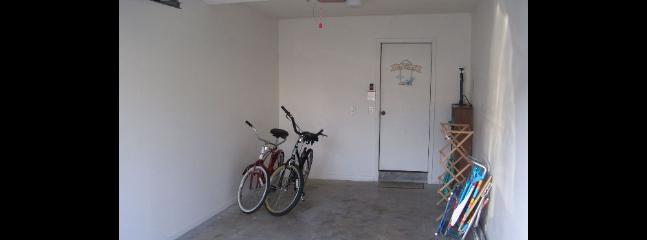 Garage with bicycles and remote door opener