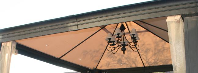 Outdoor Gazebo in Backyard features beautiful Chandelier for Evening Dining and Fun!