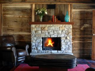 Fireplace with wood supplied to warm you up.
