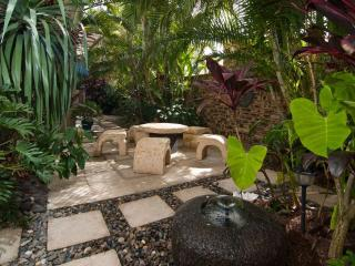 Relax in private tropical courtyard