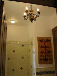 Colonial chandelier and wall tapestry in front bathroom