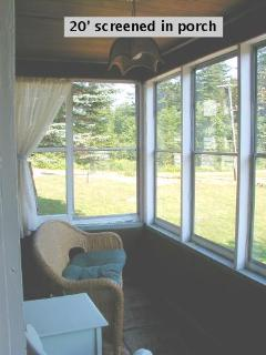 20' screened in porch adds to view of nature and pond. Porch over looks front of the cottage.