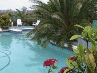 Tropical freshwater pool at Pirates Hideaway By the Sea with a special wooden deck with bar b que n