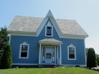 A Blue House on Louis Head Beach in Nova Scotia