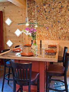 Dining area with cork and tile wall