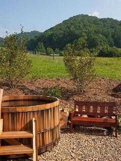 Cedar soaking tub with view of the mountains