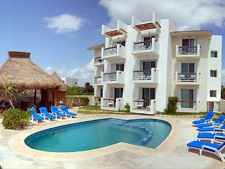 2 bedroom beachfront condos with good sized pool.  WiFi, Air Con, Sat TV!
