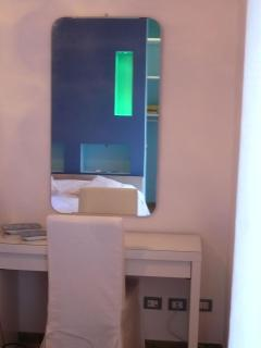 Console mirror reflecting RGB LED lamps