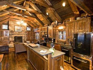 The interior blends modern conveinences with antique timbers and decor.