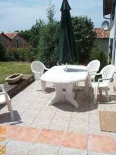 The lower patio near the BBQ, seats 8 comfortably.