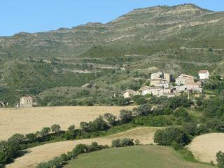 Figols nestles beneath a dramatic escarpment;Casa Rafela faces directly over orchards and fields
