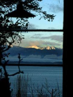 View of Olympic Mountains over Useless Bay from living room