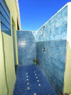 The secluded outdoor shower of the upper bathroom