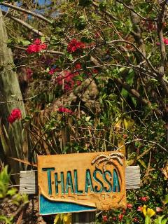 Welcome sign at Thalassa driveway entrance