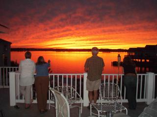 Enjoy spectacular sunsets from top level deck while dining,