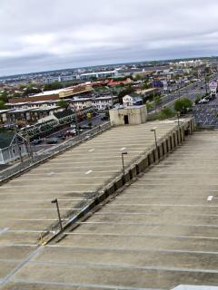 Top deck of 5 floor parking,Food store in distance