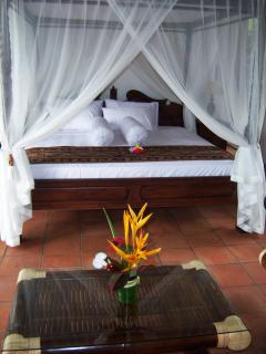 Canopied Teak antique bed in the Poolside Suite