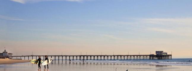 Surfers on Newport Beach