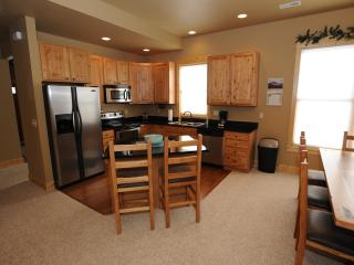 Kitchen w/Granite Counter Tops & Center Island (in each 3 bedroom)