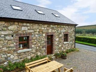 THE COACH HOUSE, pet friendly, country holiday cottage, with a garden in Gorey, County Wexford, Ref 11589
