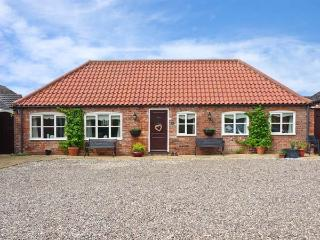 THE STABLES, pet friendly, country holiday cottage, with a patio, in Louth, Ref