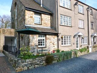 THE OLD MILL, pet friendly, country holiday cottage, with a garden in Cark In Ca