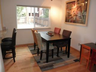 Dining Room; Table for 6, bar seating for 2. Optional kid table for 4