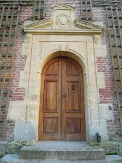 Main entrance chateau (renaissance period) with same  family coat of arms