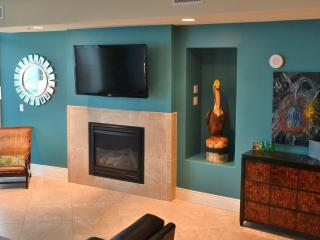 Fireplace, smart Wi-Fi TVs, Sonos wireless speakers, spacious main room